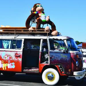 VW Bug with stuffed monkey on top.