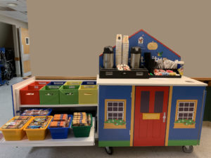 RMHC HOSPITALITY cart with coffee and donated goods for families