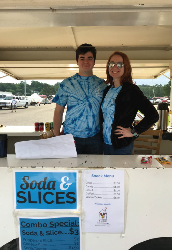 two volunteers working a concession stand at Bug-a-Palüza