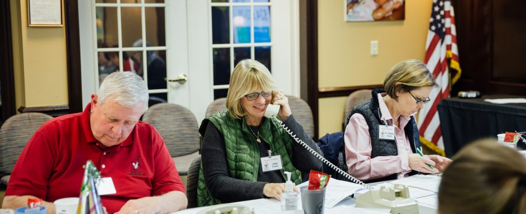 volunteers making phone calls to raise funds for share a night