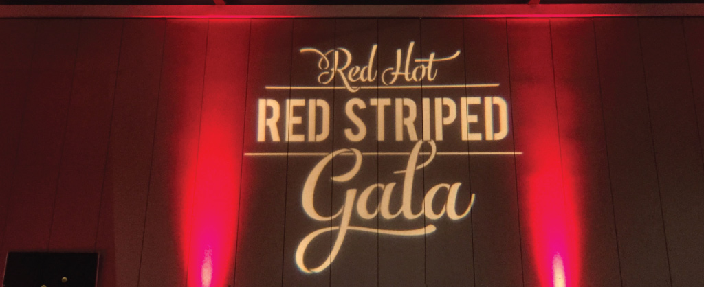 red hot red striped gala with red uplighting