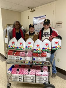 group with boxes of pop tabs to donate
